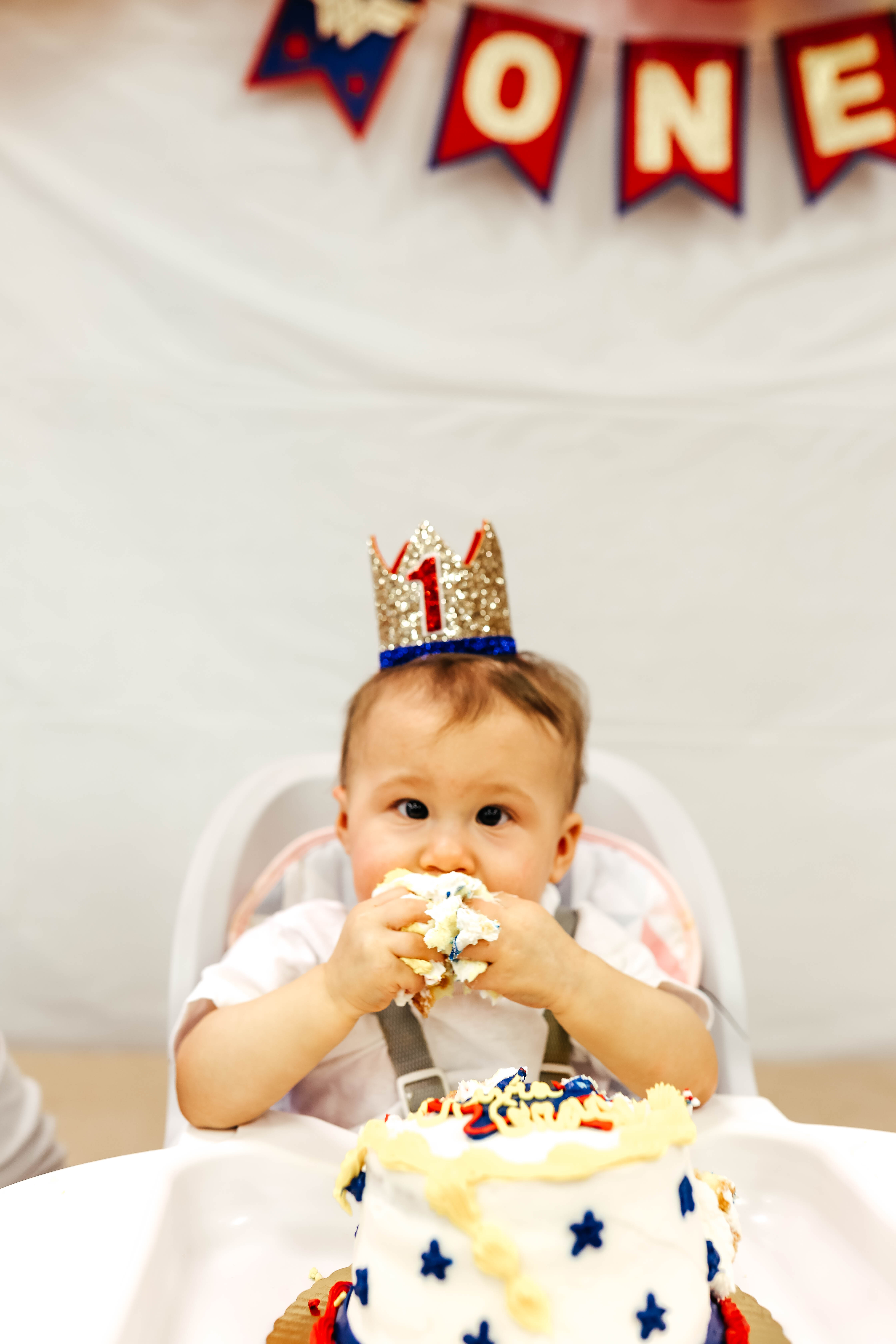 ONEder Woman 1st Birthdy Party for Olivia Grace - eating smash cake on Coming Up Roses